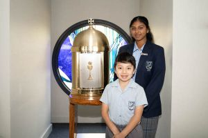 All Saints Catholic College Family and Faith - students with holy chalice