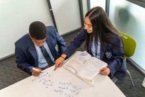All Saints Catholic College Learning and Achievement - students resolving a maths equation