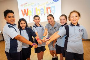 All Saints Catholic College News and Events students showing wrist ribbons