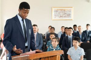 All Saints Catholic College Religious Life of the School - student reading the Bible