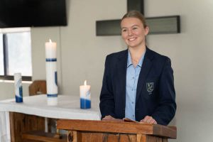 All Saints Catholic College Shared Mission - student speaking in front of mass