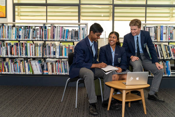 All Saints Catholic College Student Voice - students in discussion at the library