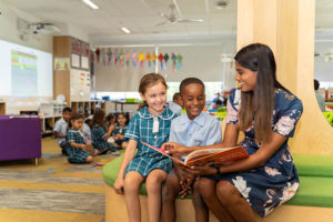 casual-teaching-at-All-Saints-Casula-Liverpool teacher reading book with students